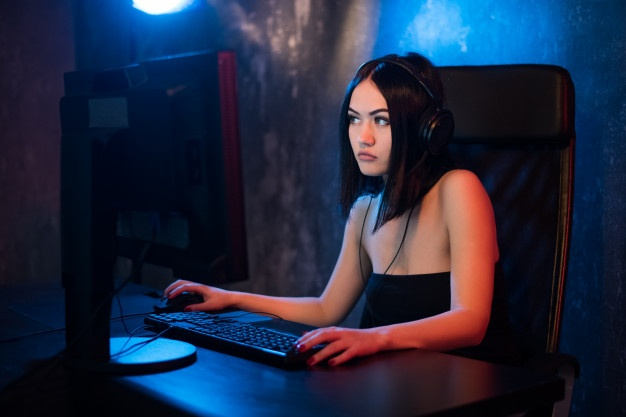 Female gamer looks worried due to the issues she faces such as harrassment, sexism and online gaming abuse.